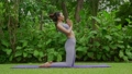 Portrait of a young woman doing yoga in the garden for a workout. Concept of lifestyle fitness and healthy. Asian women are practicing yoga in the park. 79546021
