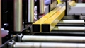 metal part moves along the rollers of the machine in production 80116634