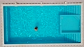 Adult married couple in swimming pool splashing water. Newlyweds on their honeymoon relaxing on tropical resort. Man and woman kiss and hug in basin with cool refreshing water at sunny day top down 80269681