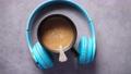 black color coffee mug and a head phone on table  80351125