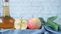 apple vinegar in glass bottle with fresh green apple on table  80352243