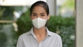 Asian woman wearing face mask to protect from coronavirus Covid-19 80448085