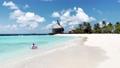 Little girl playing on the ocean beach 81182797