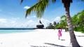 Little girl playing on the ocean beach 81182852