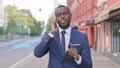 Outdoor Walking African Businessman Talking on Phone 81572227
