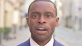 Outdoor Close up of Shocked African Businessman 81576692