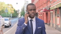Walking African Businessman Getting Angry on Phone Call 81578197