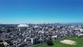 ナゴヤドームから望む昼間の名古屋駅(上昇) 81594005