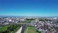 ナゴヤドームから望む昼間の名古屋駅(旋回) 81594006