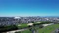 ナゴヤドームから望む昼間の名古屋駅(前進) 81594009