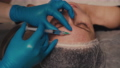 Beauty and injections concept. Close-up of a beautician giving an injection into the forehead of a woman. 81890108