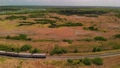 Aerial of railroad with a cargo train in Florida countryside 82648747