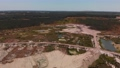 Aerial view of opencast mining quarry with ponds 82648748