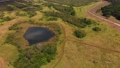Aerial view of Florida countryside with a pond and walking trails 82648751